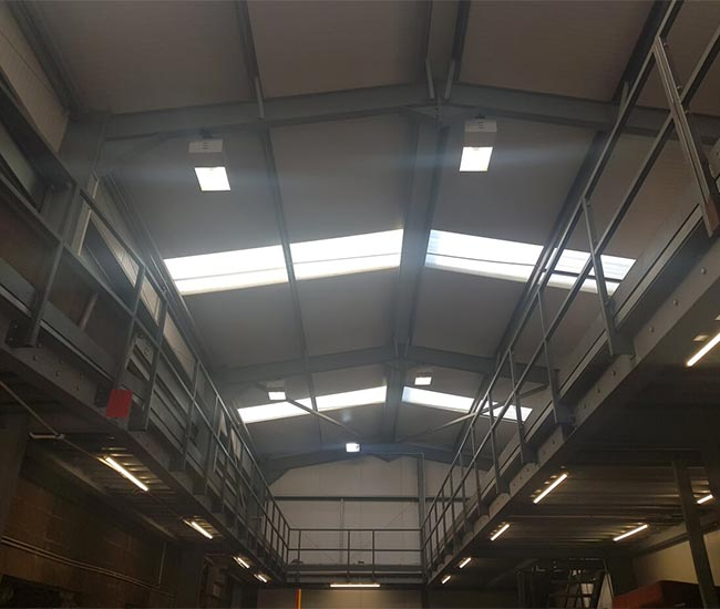 Inside the new GTE workshop with a high walkway